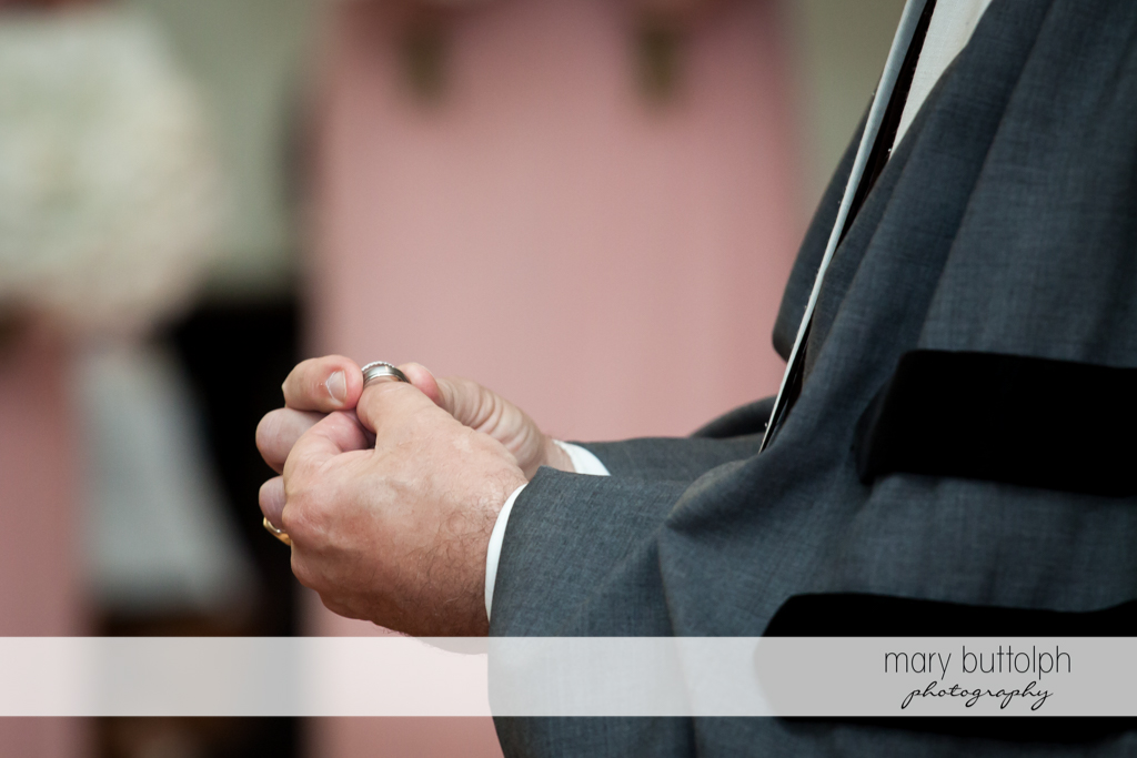 Groom holds the wedding ring at The Lodge at Welch Allyn Wedding