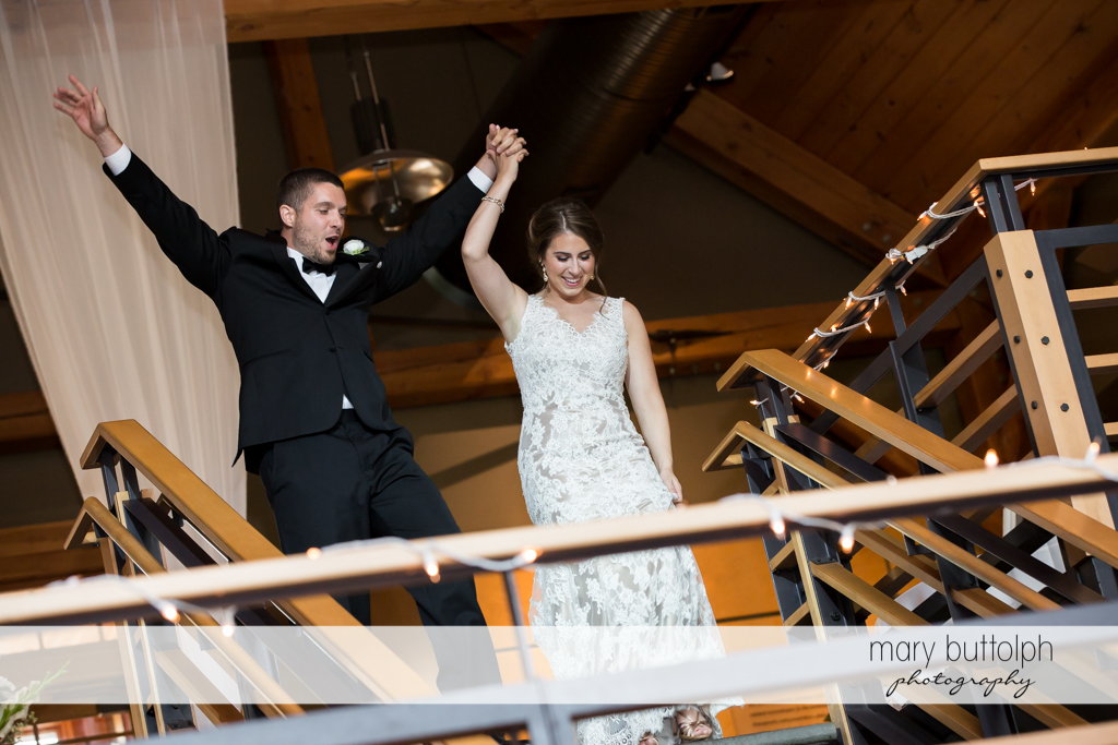 Couple make their grand entrance at the wedding reception at The Lodge at Welch Allyn Wedding