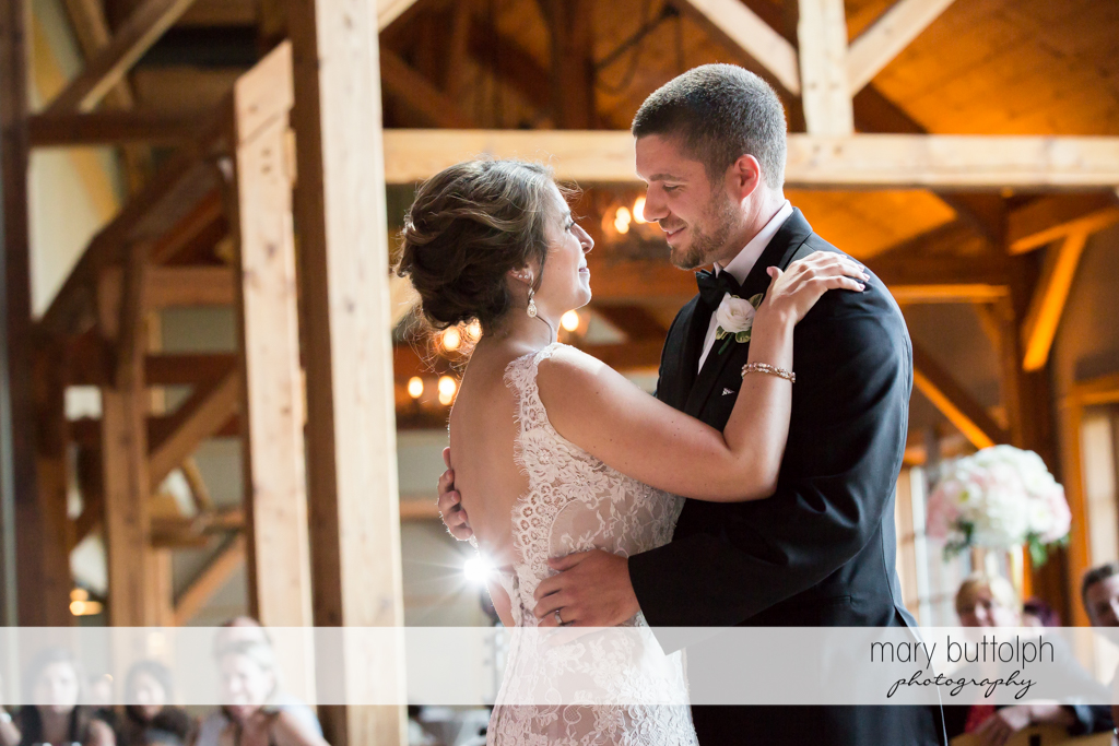 Couple dance as guests look on at The Lodge at Welch Allyn Wedding