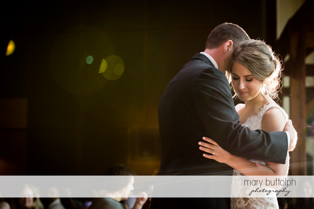 Couple dance to soft music at The Lodge at Welch Allyn Wedding