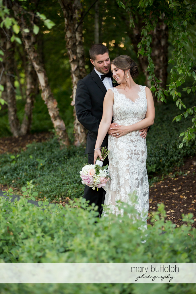 Couple relax in the garden at The Lodge at Welch Allyn Wedding