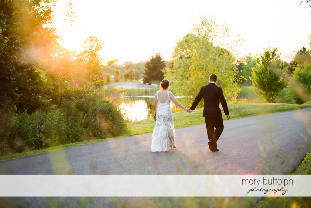 Couple travel down the road at The Lodge at Welch Allyn Wedding