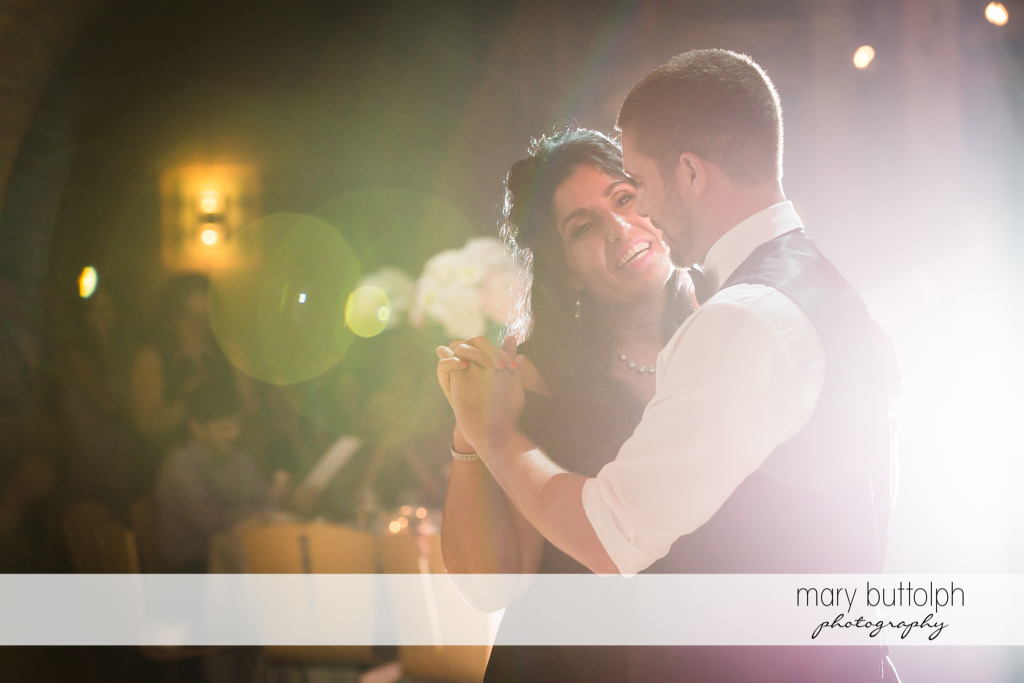 Groom and guest dance to the music at The Lodge at Welch Allyn Wedding