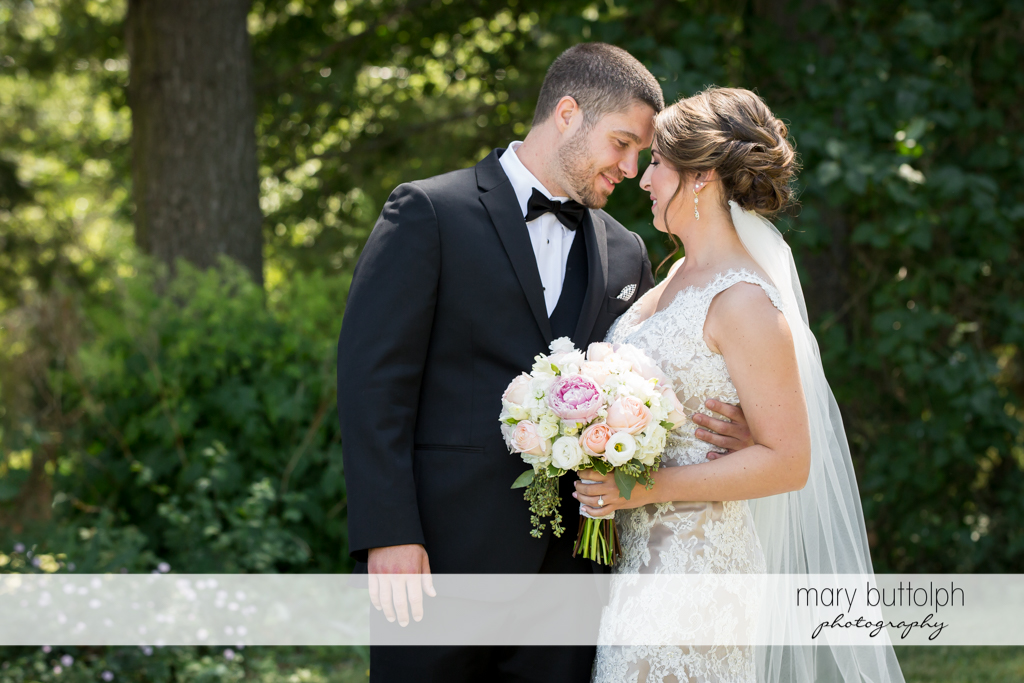 Couple pose in the garden at The Lodge at Welch Allyn Wedding