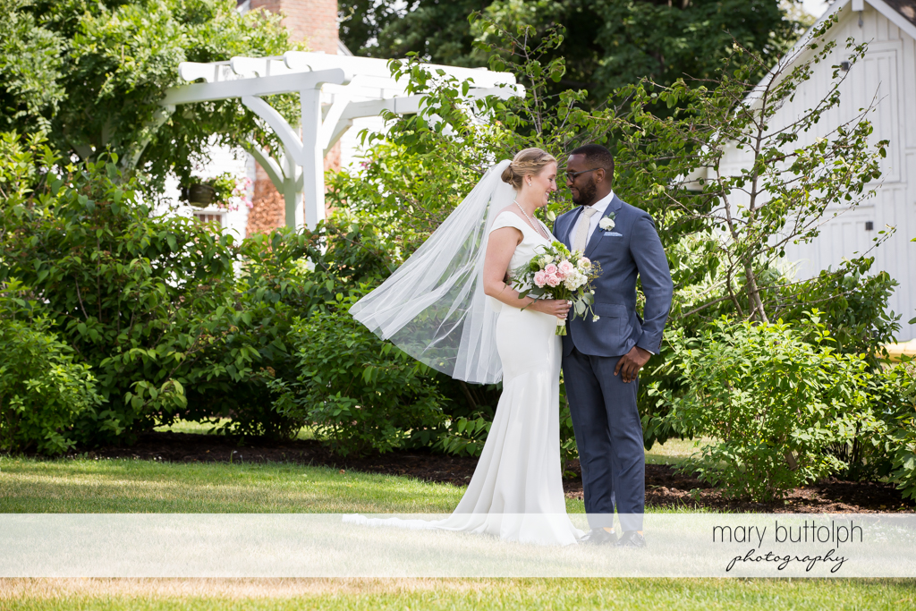 Couple pose in the garden at the Inns of Aurora Wedding