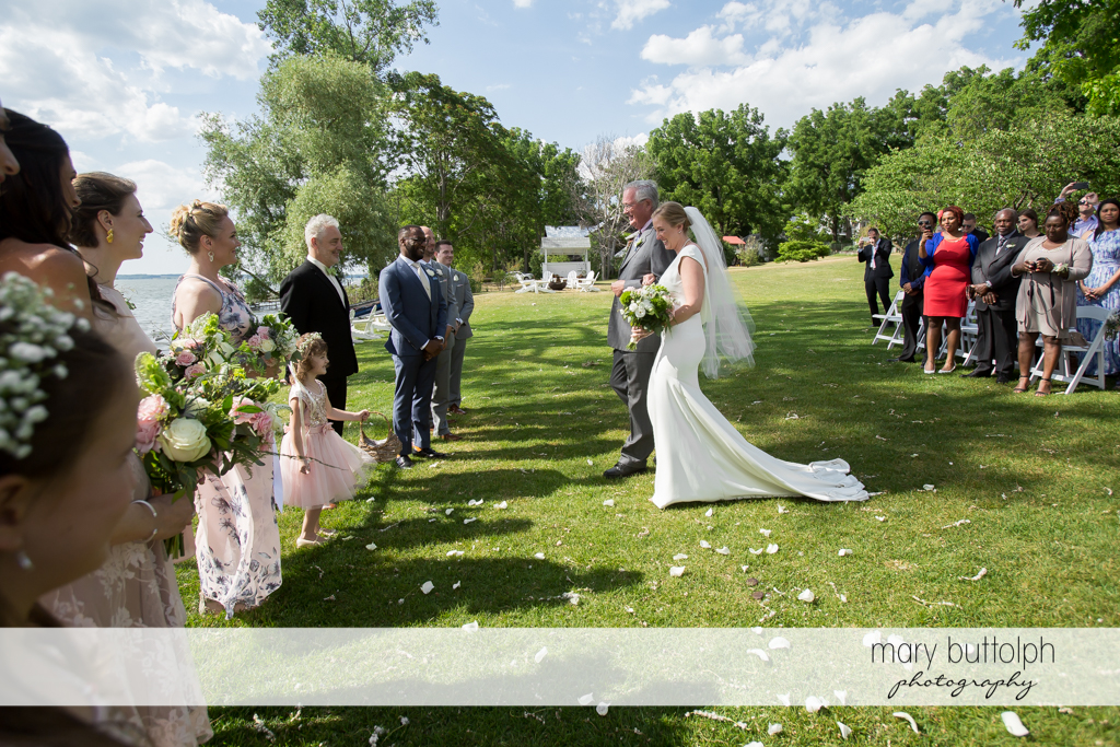 Bride and her father approach the groom in the garden at the Inns of Aurora Wedding