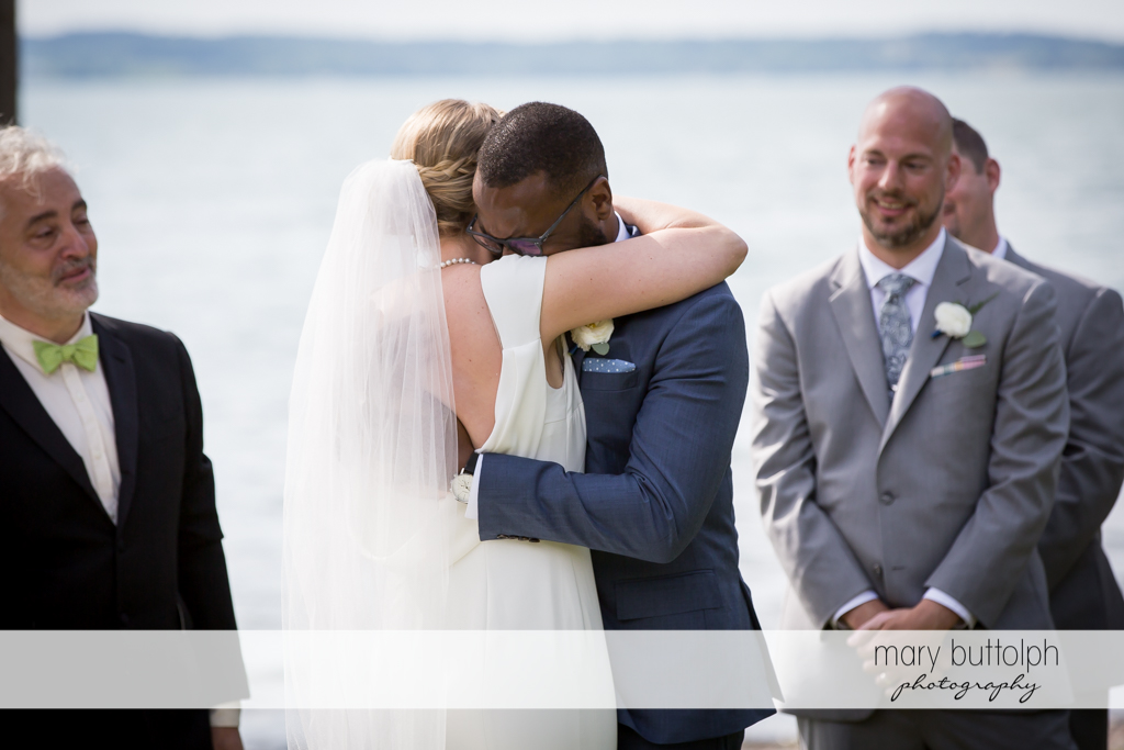 Couple embrace during the wedding ceremony at the Inns of Aurora Wedding