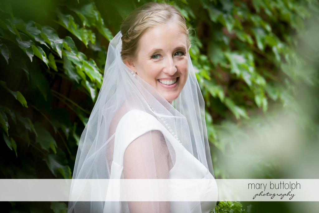 Bride in close up shot in the garden at the Inns of Aurora Wedding