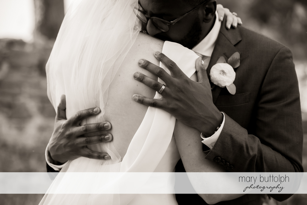 Couple in loving embrace at the Inns of Aurora Wedding