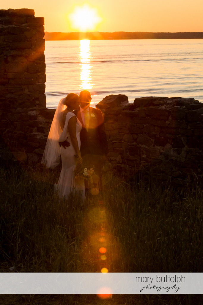 Couple watch the sunset at the Inns of Aurora Wedding
