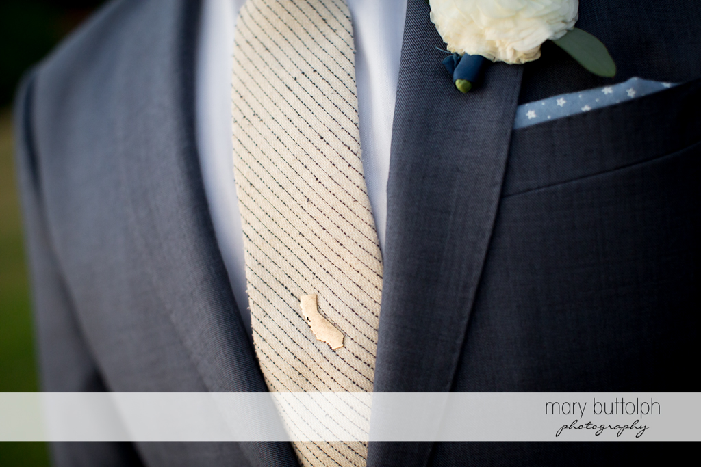 Close up of groom's tie pin at the Inns of Aurora Wedding