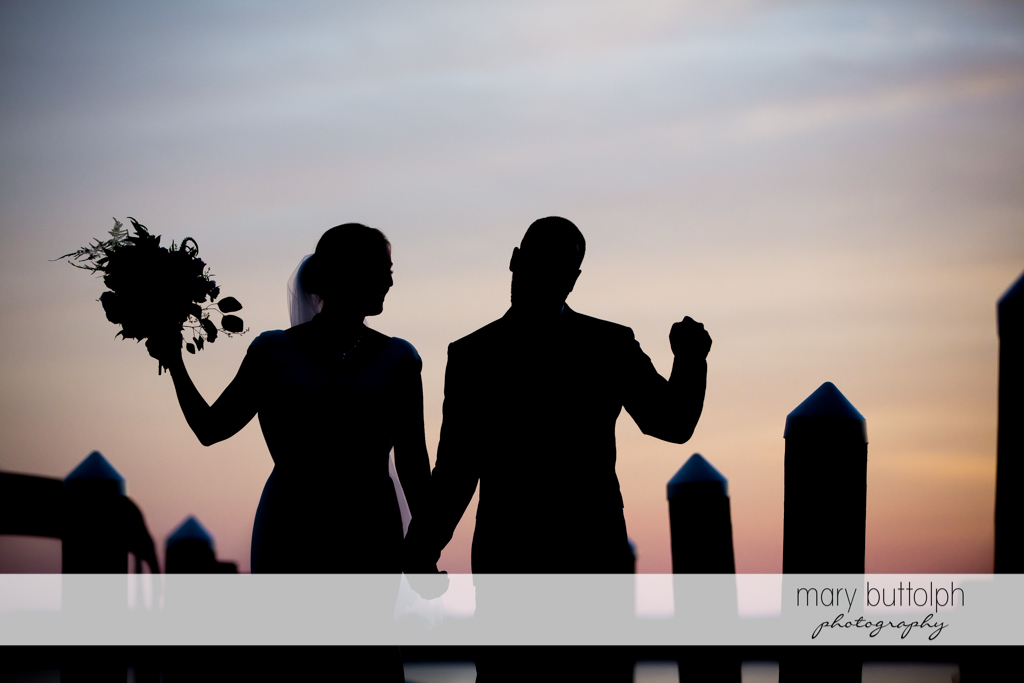 Couple greet the sunset by the lake at the Inns of Aurora Wedding
