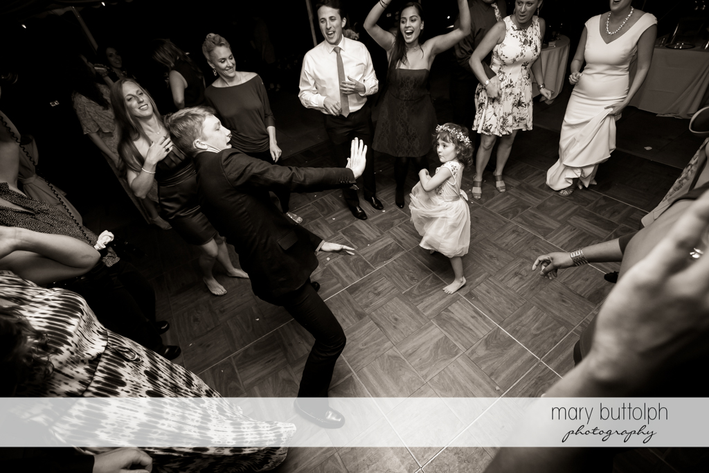 Guest dances with flower girl at the Inns of Aurora Wedding