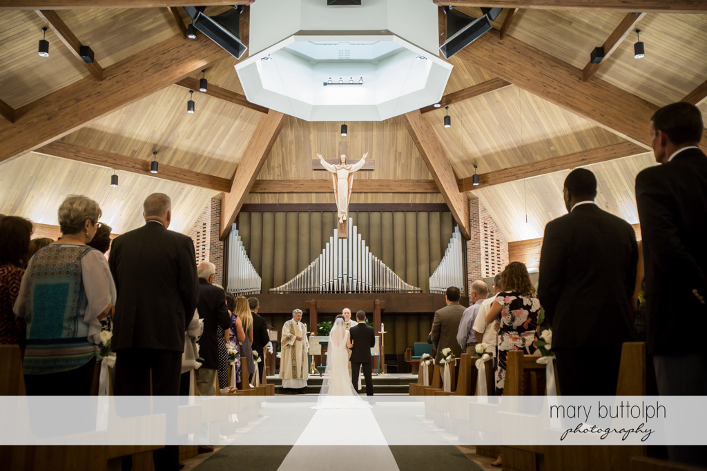Couple stand in front of the altar at Genesee Grande Hotel Wedding