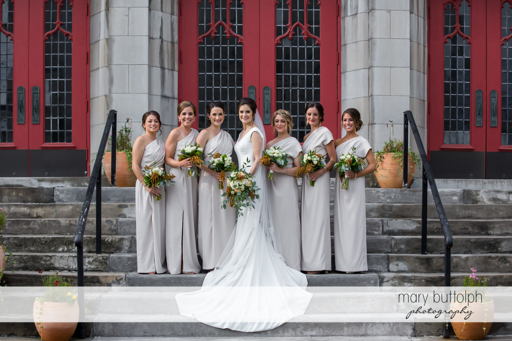The bride and the bridesmaids outside the church at Genesee Grande Hotel Wedding