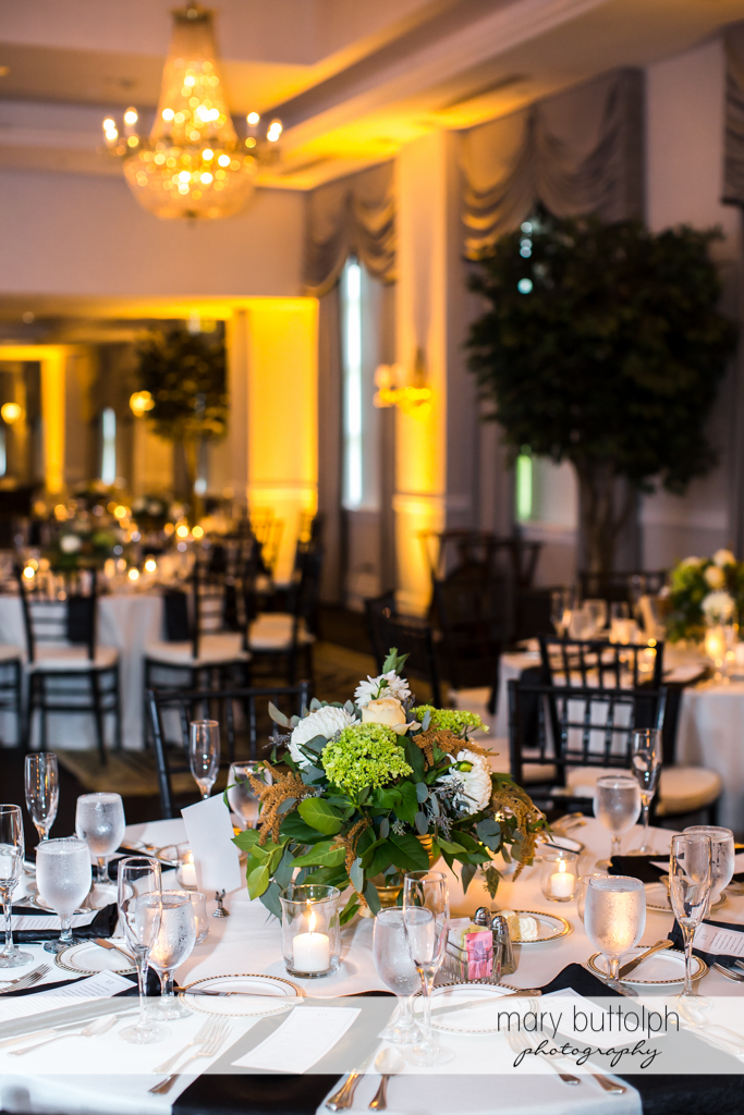 The dining tables at the wedding venue are decorated with flowers at Genesee Grande Hotel Wedding