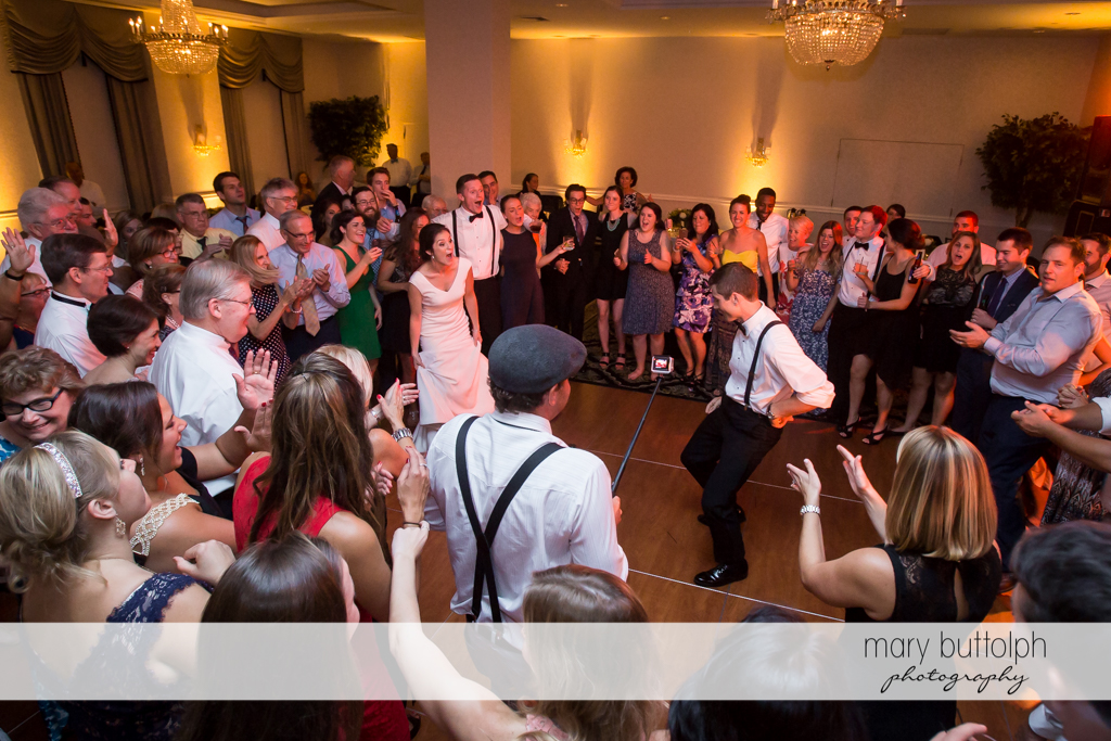 Groom flaunts his dancing skills to the delight of guests at Genesee Grande Hotel Wedding