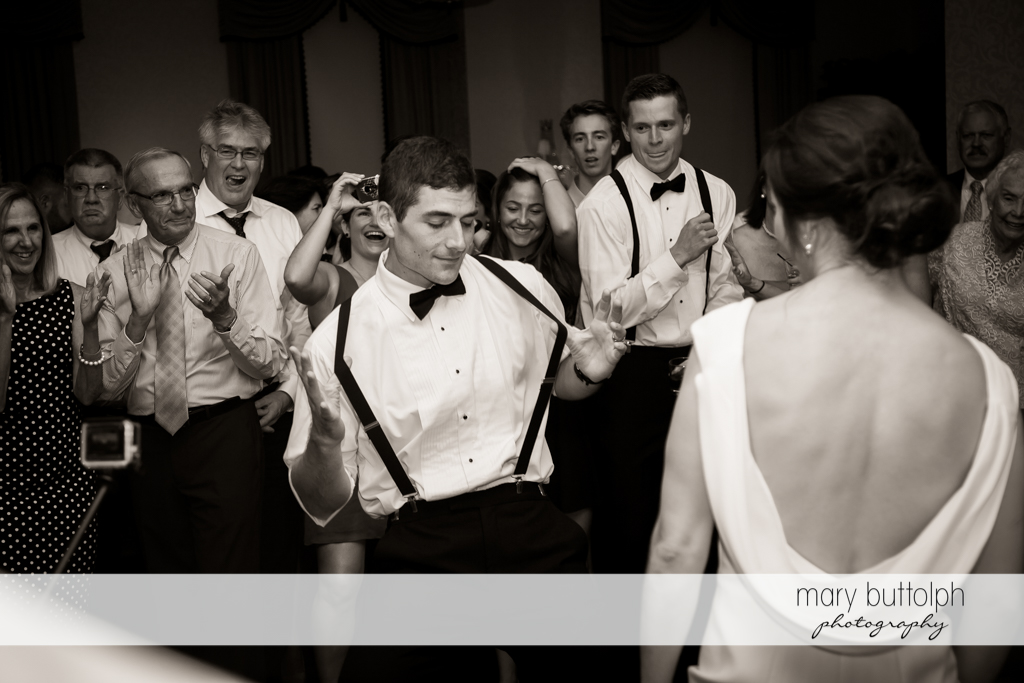 Groom makes a move on the dance floor at Genesee Grande Hotel Wedding