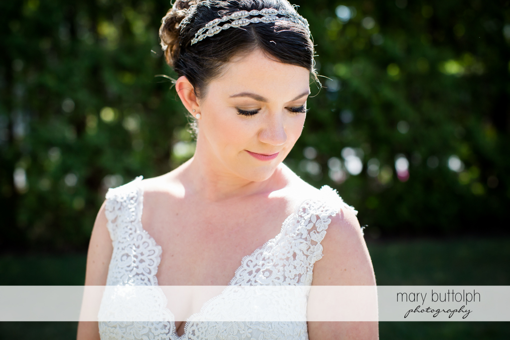 Bride poses in the garden at The Sherwood Inn Wedding