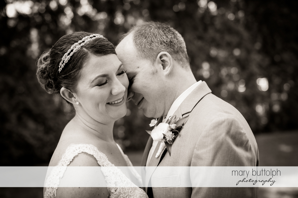 Couple share a tender moment in the garden at The Sherwood Inn Wedding