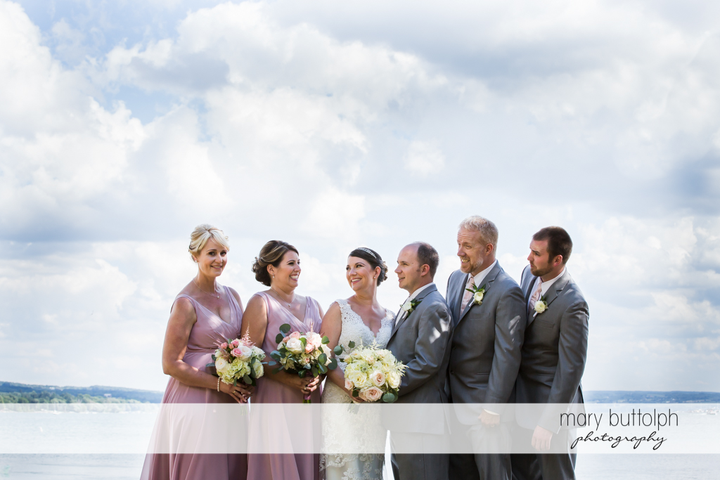 Couple are flanked by bridesmaids and groomsmen in the park at The Sherwood Inn Wedding