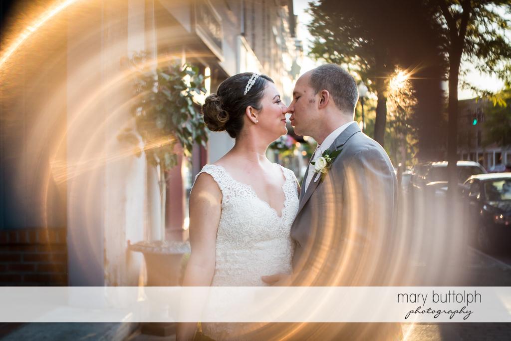 Couple kiss outside the wedding venue at The Sherwood Inn Wedding