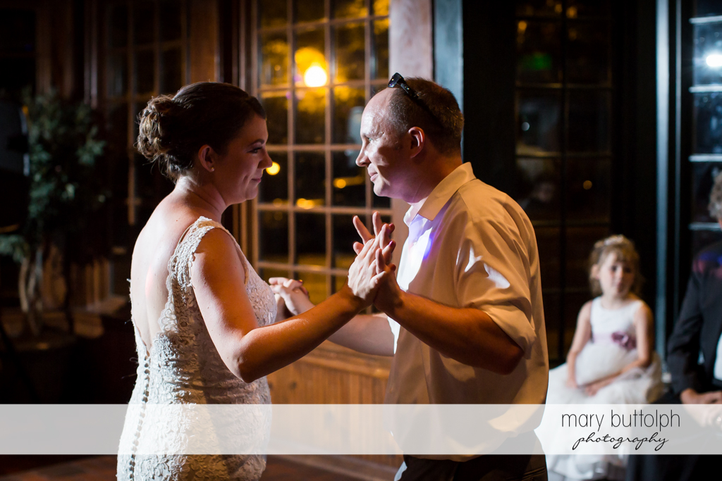 Couple dance as bride's daughter watches them at The Sherwood Inn Wedding