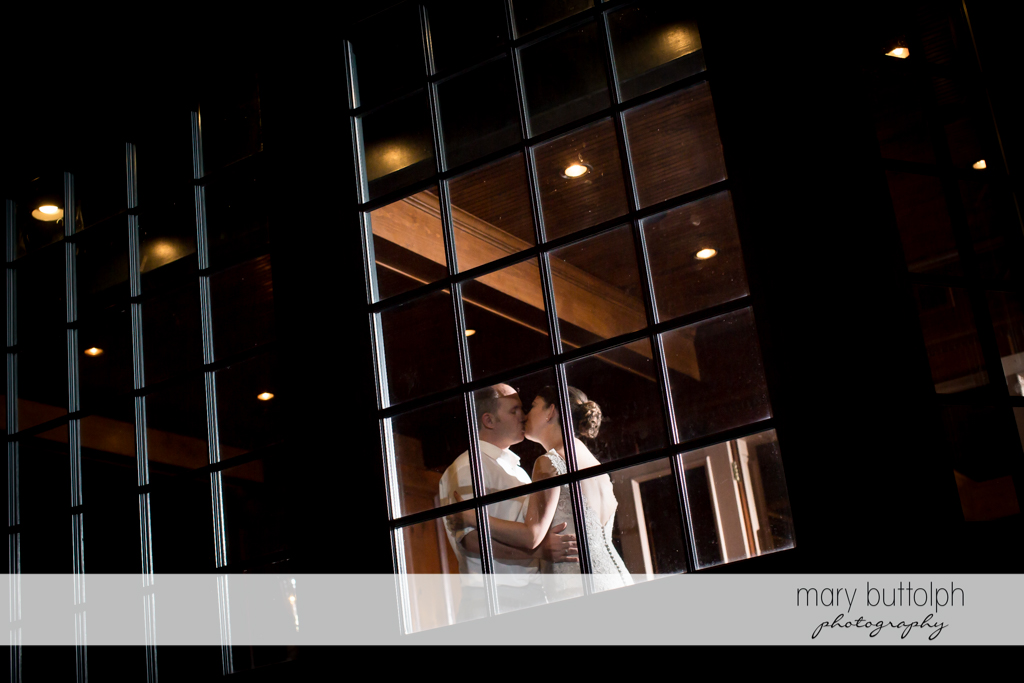 Couple kiss by the window at The Sherwood Inn Wedding