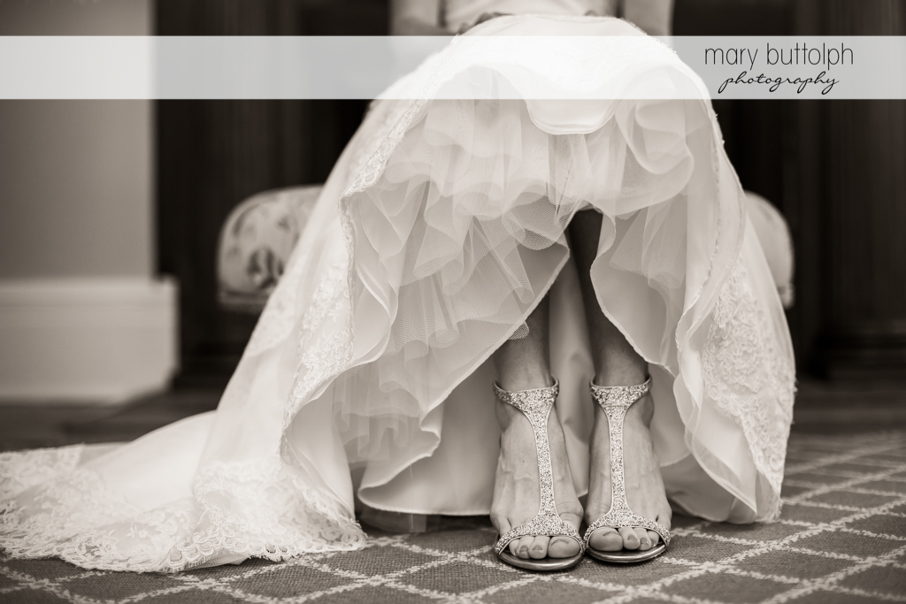 Bride's shoes take the spotlight in this photo at Skaneateles Country Club Wedding