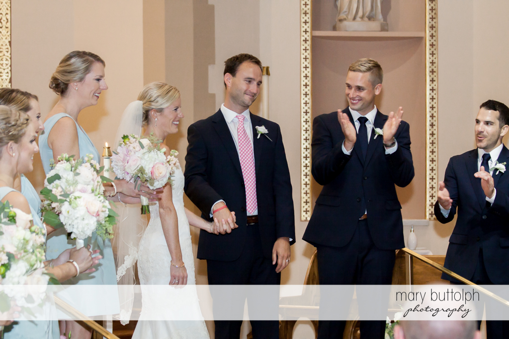 Couple share the limelight with bridesmaids and groomsmen at Skaneateles Country Club Wedding