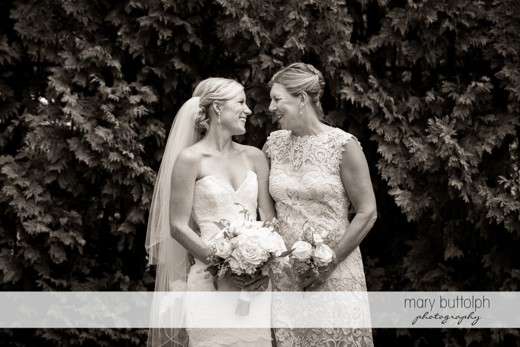 Bride talks to her mom in the garden at Skaneateles Country Club Wedding
