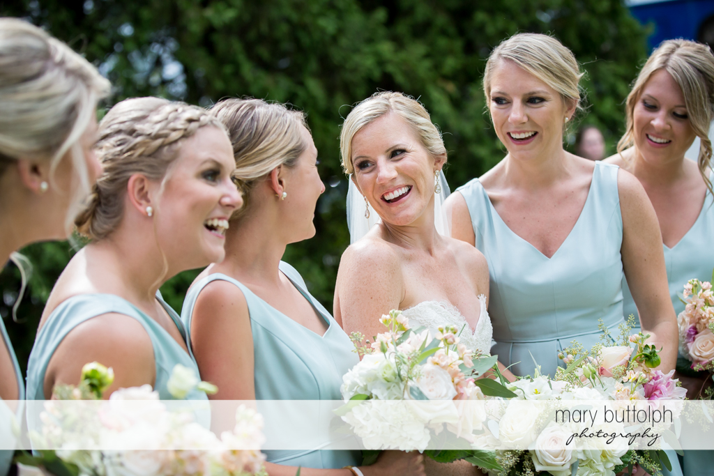 Bride enjoys the company of her bridesmaids at Skaneateles Country Club Wedding