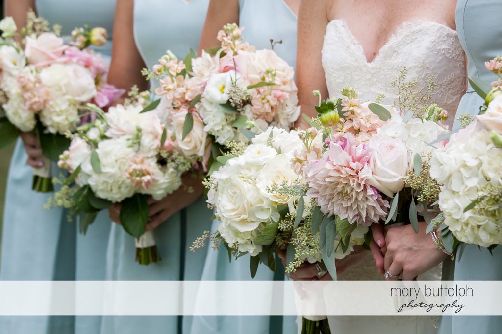 Bride and her bridesmaids holding beautiful bouquets at Skaneateles Country Club Wedding