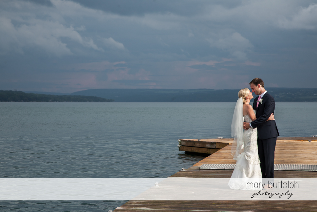Couple in lakeside shot as night approaches at Skaneateles Country Club Wedding