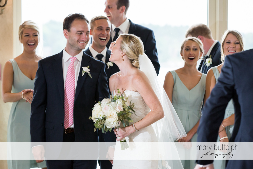 Couple in a light moment with guests at Skaneateles Country Club Wedding