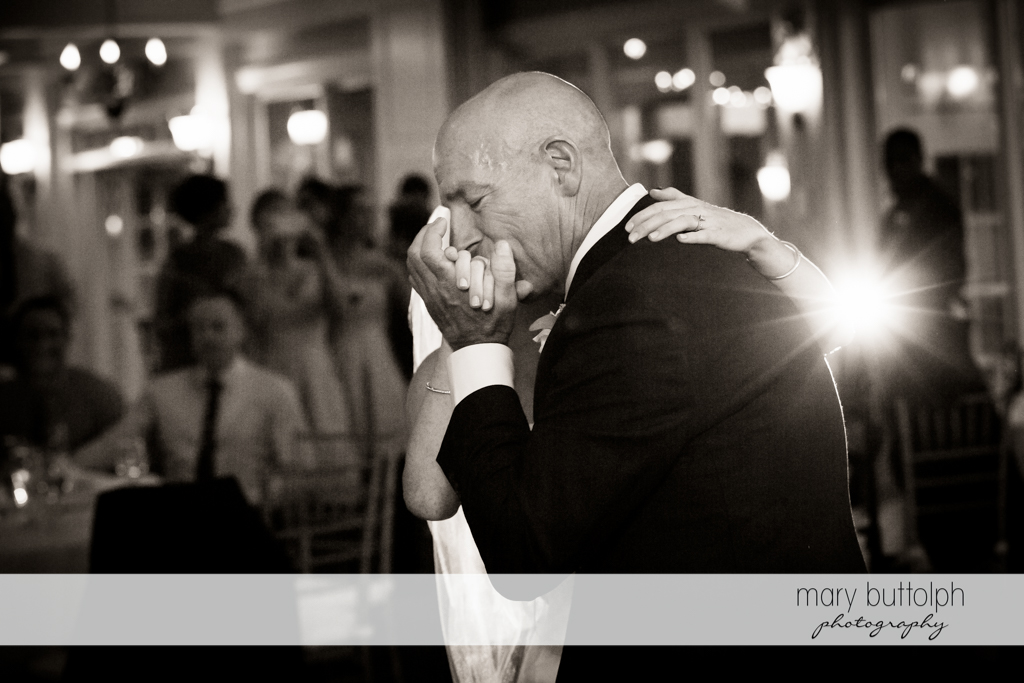 Bride's father kisses his daughter's hand at Skaneateles Country Club Wedding