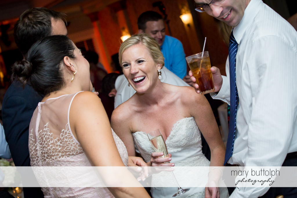 Bride mingles with guests at Skaneateles Country Club Wedding
