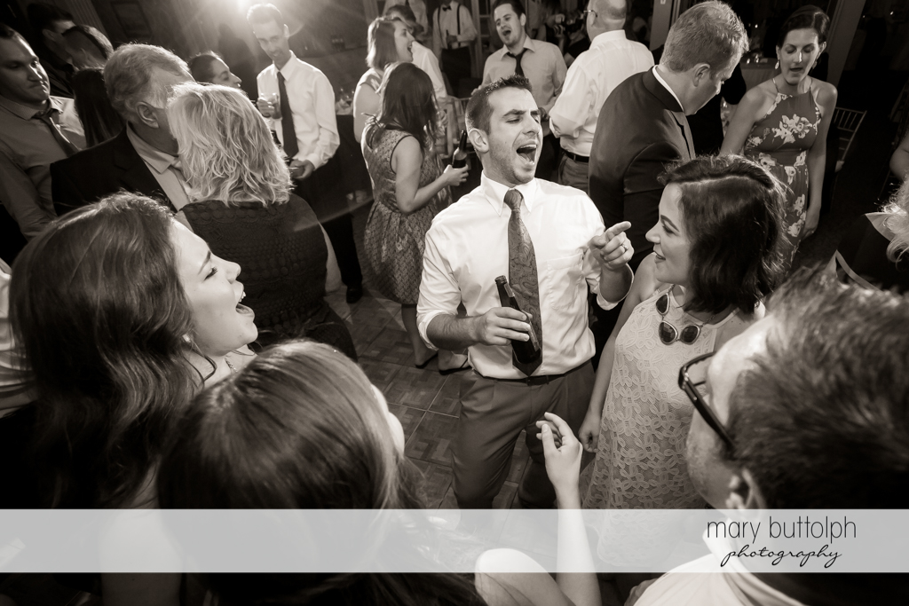 Guests have a great time at the wedding reception at Skaneateles Country Club Wedding
