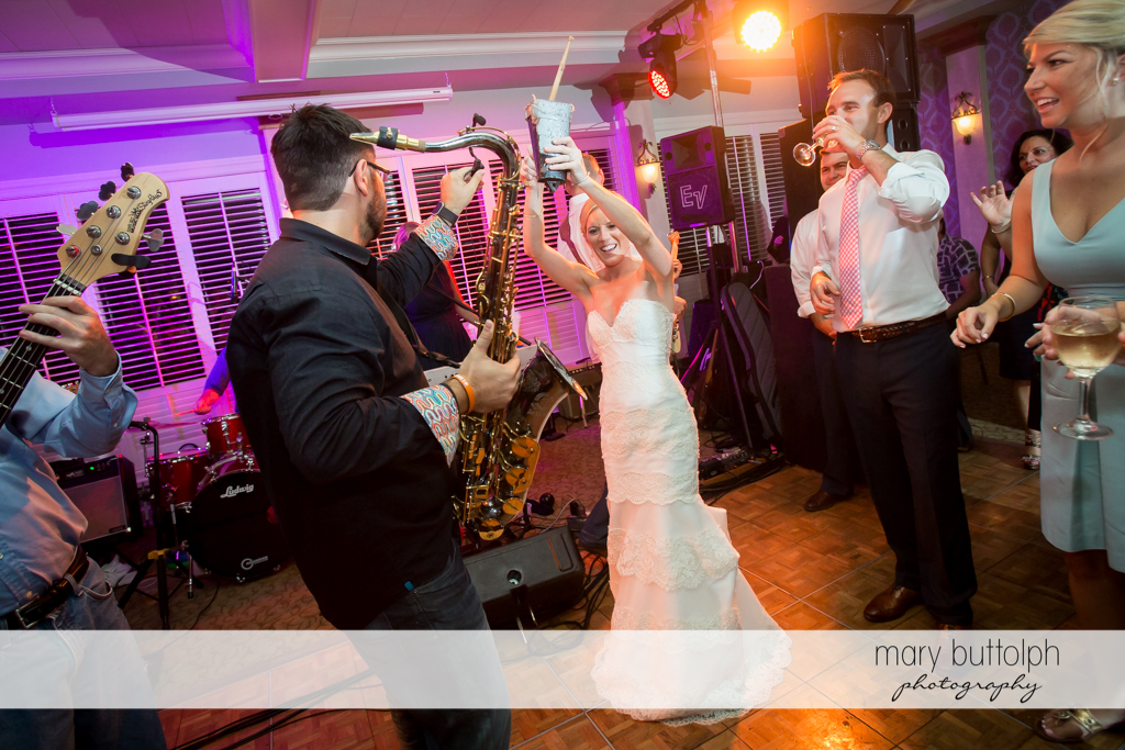 Bride joins the band at the wedding reception at Skaneateles Country Club Wedding