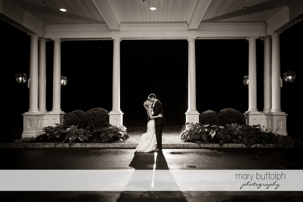 Couple embrace outside the wedding venue at Skaneateles Country Club Wedding