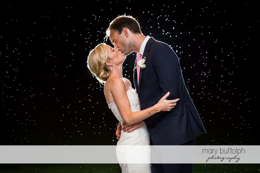 Couple kiss under the starry night at Skaneateles Country Club Wedding