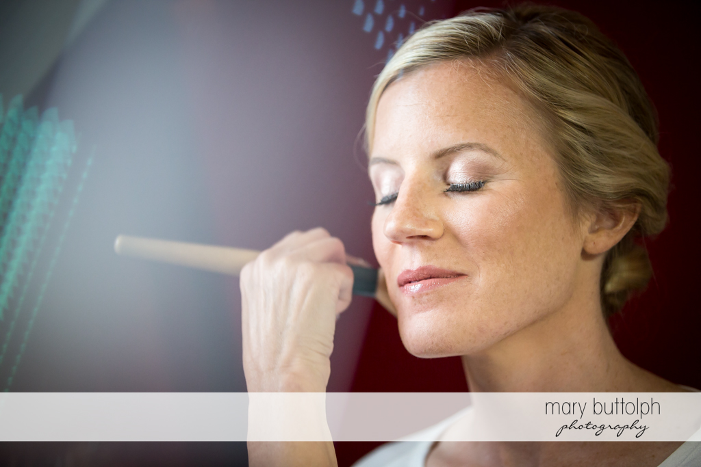 Bride is made up for her wedding at Skaneateles Country Club Wedding