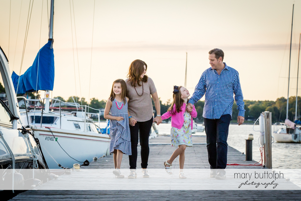 Family strolls near the sailboats at Skaneateles Country Club