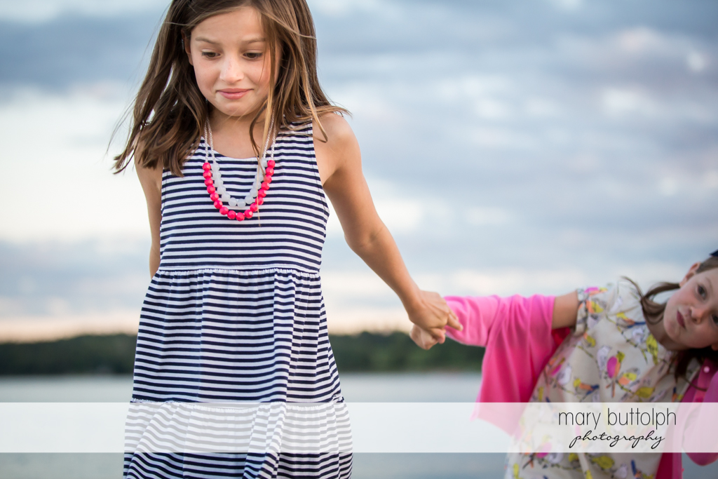 Girls walk near the lake at Skaneateles Country Club