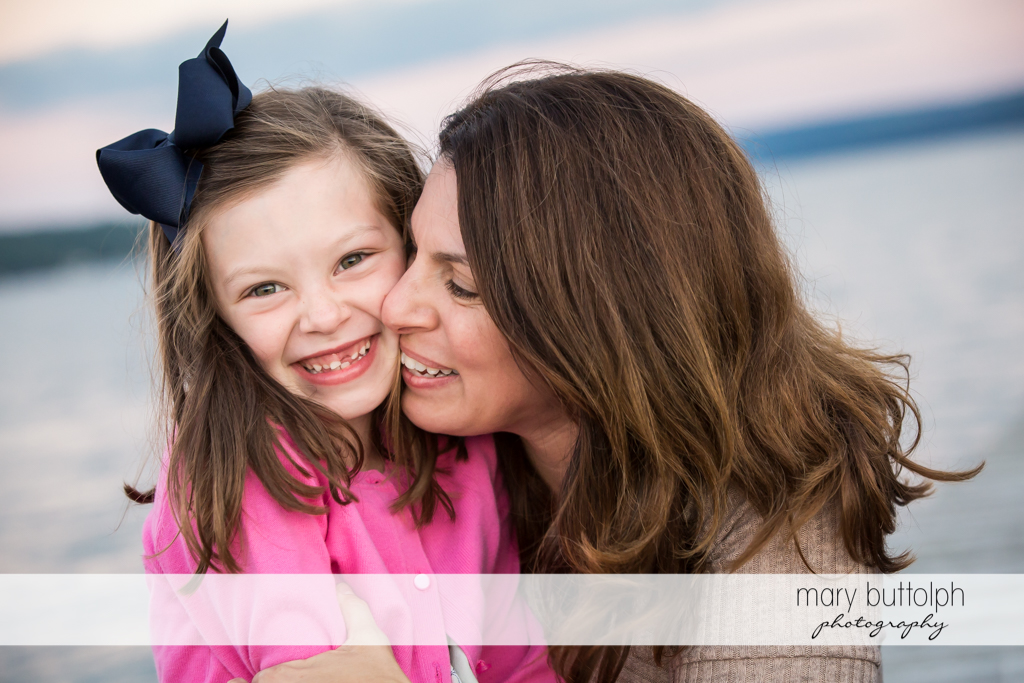 Woman and daughter share a tender moment at Skaneateles Country Club