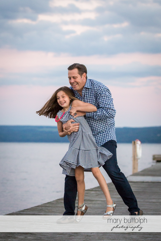 Man and her daughter have fun near the lake at Skaneateles Country Club