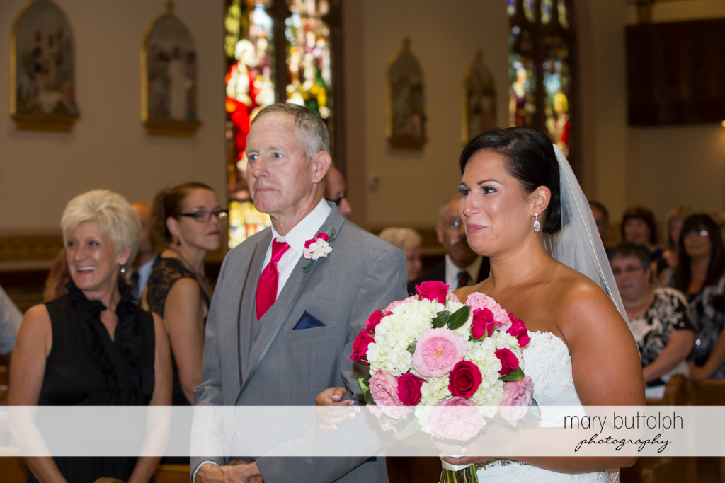Bride and her father approach the altar at The Lodge at Welch Allyn Wedding