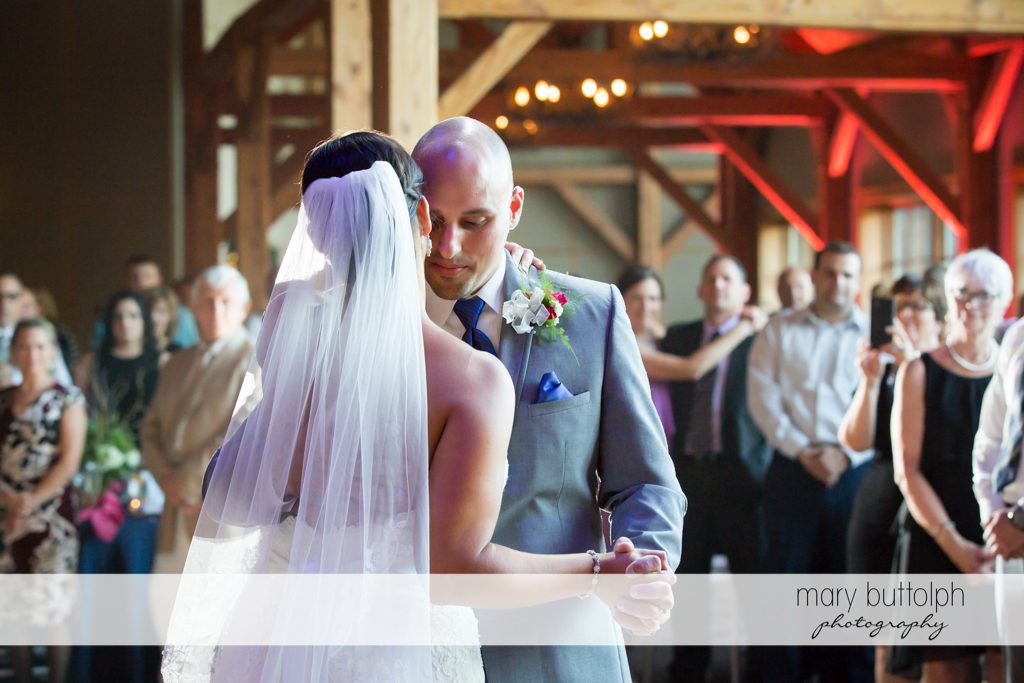Couple dance cheek to cheek at The Lodge at Welch Allyn Wedding