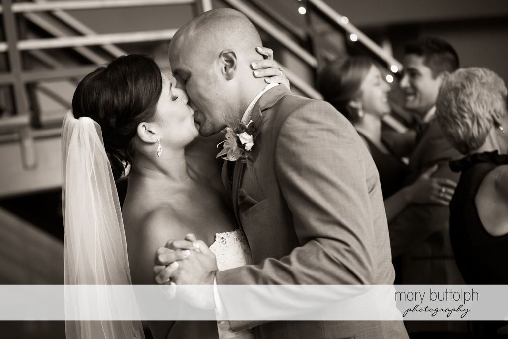 Couple kiss as they dance at The Lodge at Welch Allyn Wedding