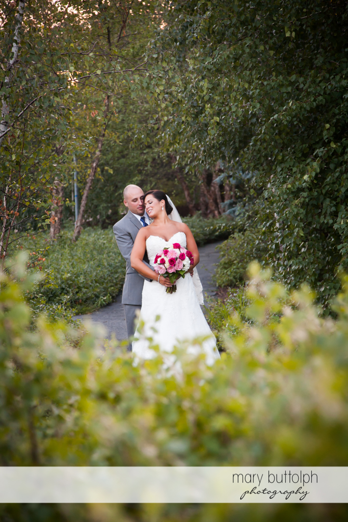 Couple share a quiet moment in the garden at The Lodge at Welch Allyn Wedding